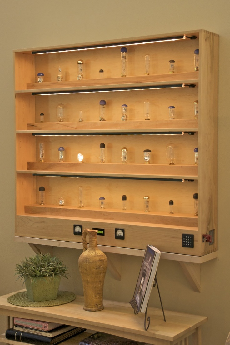 A cabinet made out of of maple to house 32 of my favorite old projector lamps.  They are lit briefly, at low voltage, by a BASIC Stamp microcomputer running a pseudo-random number generator.