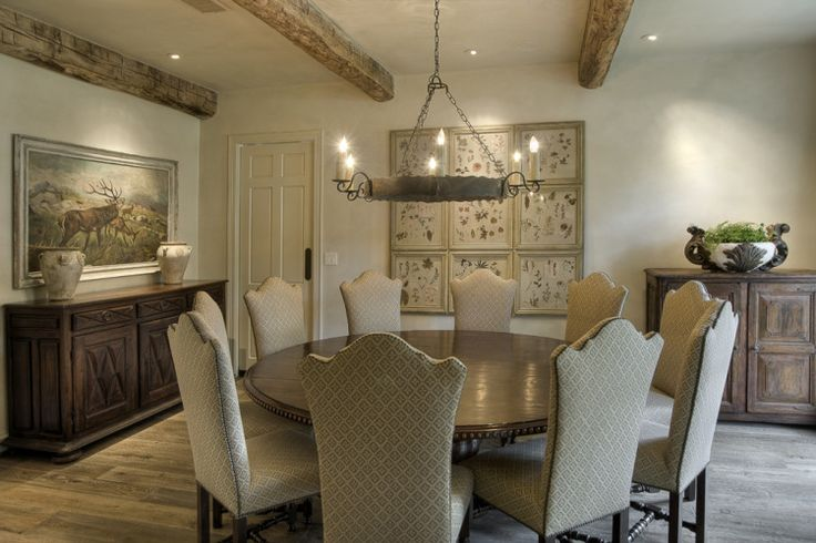 I've never really considered it, but I think I love the idea of a LARGE round table for the dining room rather than square or rectangle.