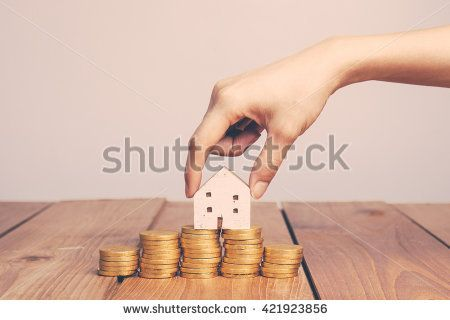 vintage tone of Real estate investment. House and coins on table.