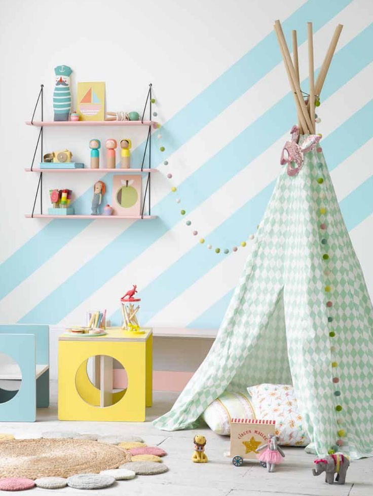 Pretty pastels in this kids zone ... indoor teepees are great ways to inspire pretend play.