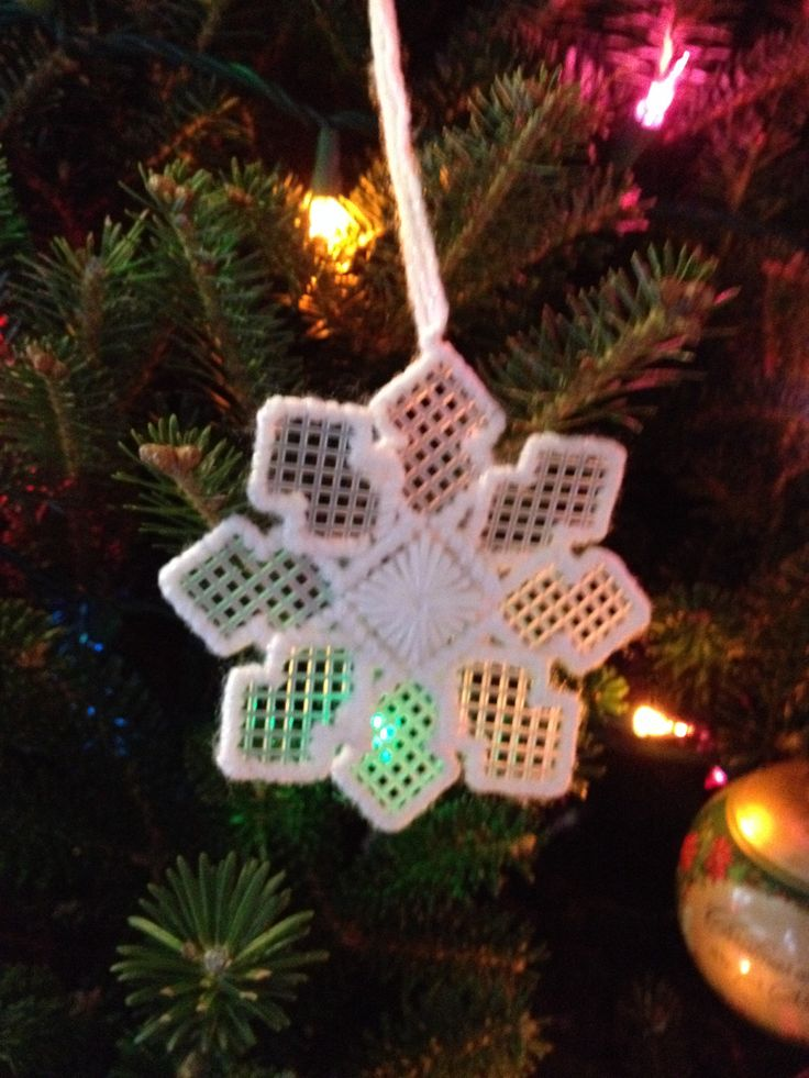 Plastic canvas snowflake - although, I think I would use a white and silver blend to make it shimmer/sparkle a little.