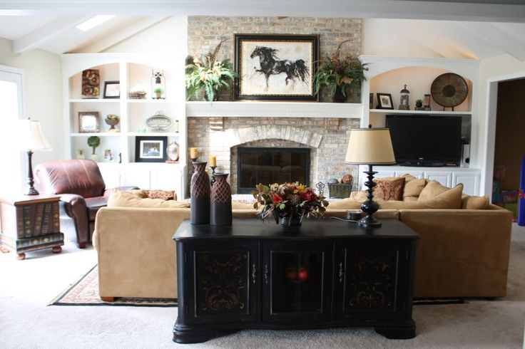 fireplace with symmetrical built ins for tv and shelving