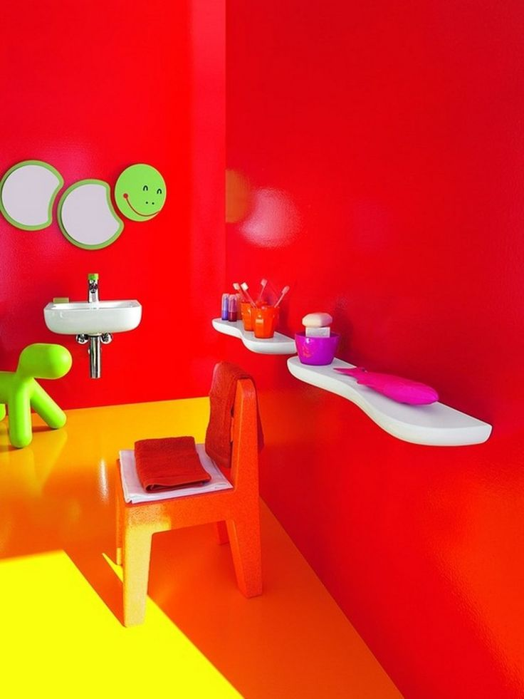 Top 17 Colorful Kids Bathroom Design Ideas : Cute Red Painted Wall Colorful Kids Bathroom with Worm Shaped Bathroom Mirror and Orange Chair