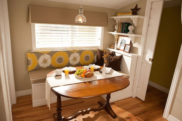 traditional corner kitchen set with white wooden bench, brown seating cushion, yellow flower back cushion, roudn wooden table, white wooden shelves, pendant of A Kitchen Corner Lively in Design and Colors