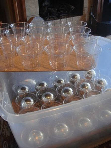 Glue plastic cups to cardboard and then stack them in plastic bin to safely store Christmas ornaments.