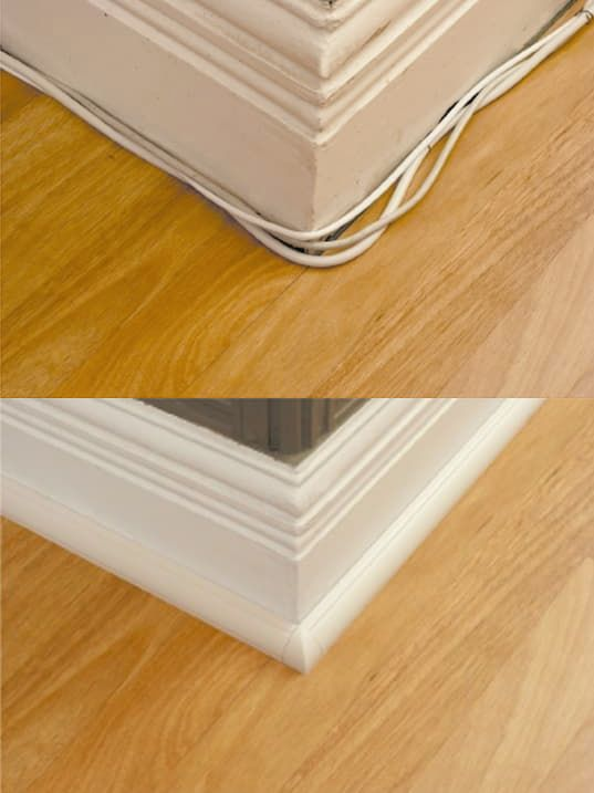 Run cable wires along the floor with molding covers.