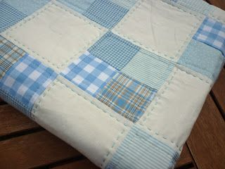 such a pretty baby quilt, the hand sewn stitches on some blocks are what really stand out
