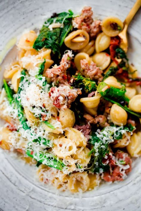 pasta tossed with Italian sausage, broccoli rabe, sun-dried tomatoes ...