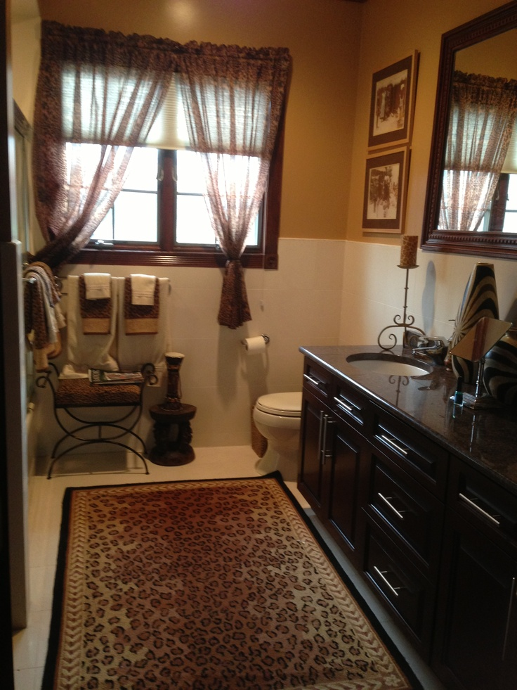 Safari style bathroom with leopard print accents design for Zebra print and red bathroom ideas