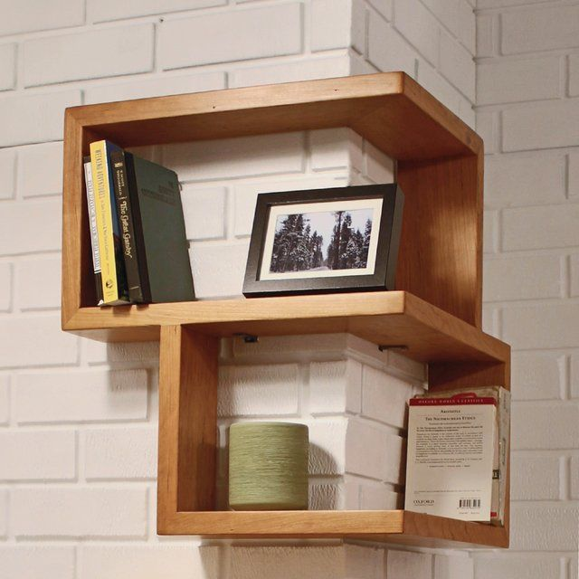 "The award nominated Franklin Shelf is a 90 degree corner shelf. This unique design allows for maximum storage space, while occupying a very small area. The smooth wooden finish of this shelf will make a great addition to any corner, table, or desktop. Its sturdy build allows it to be hung or stand on its own. Material: Cherry wood, Maple, Walnut Dimensions: 23.75"" x 20"" x 20"" Made in USA Please allow 2-4 weeks for shipping"