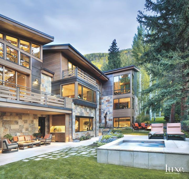 """""""Our thought was to protect and enhance the natural characteristics of the site, incorporate the house within it and capture the views,"""" architect Michael Suman of Suman Architects says of a house he designed for a family in Vail Valley. Random-square sandstone, split brownstone, copper cladding and clear cedar siding mark the dynamic façade and integrate the structure with its surroundings. #EyeOnDesign2017 #homeandcandle #homeandgarden #design #homedecor #inspire #comfort #athome #decorate"""