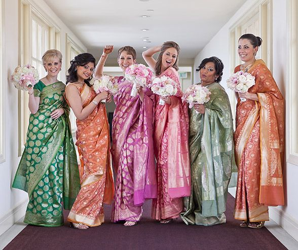 The bridesmaids donned colorful saris in shades complimemtary to the wedding palette.