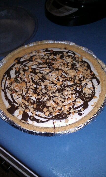 Nutty Buddy Pies 3 graham cracker pie crusts 1 cup milk 1 cup crunchy Peanut Butter 2 cups Powdered sugar 8oz cream cheese 16oz cool whip  Mix together milk, pb,sugar, cream cheese with mixer until well blended.  Then mix in cool whip. Pour into pie crusts. Drizzle top of each pie with chocolate Magic Shell ice cream topping and chopped nuts.  Keep frozen....I like to thaw it for a few minutes before I serve.  Enjoy!