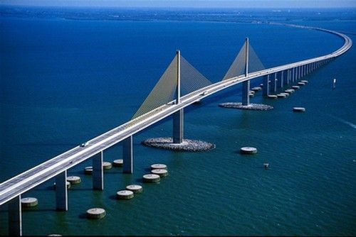 The Sunshine Skyway Bridge is a bridge spanning Tampa Bay, Florida, with a cable-stayed main span, and a total length of 21,877 feet (4.1 miles or approximately 6.67 km). It is part of I-275 (SR 93) and US 19 (SR 55), connecting St. Petersburg in Pinellas County and Terra Ceia in Manatee County, Florida, passing through Hillsborough County waters.