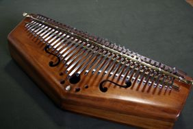 Kalimba : : also known as the Mbira or thumb piano, is made in a wide variety of designs.