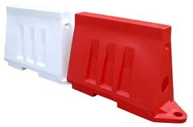 Rotationally moulded road barrier.