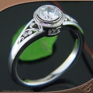 Palladium bezel engagement ring with miligrain and filigree detailing