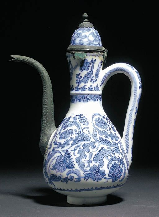 A Kutahya blue and white pear-shaped ewer and a cover First half 18th century