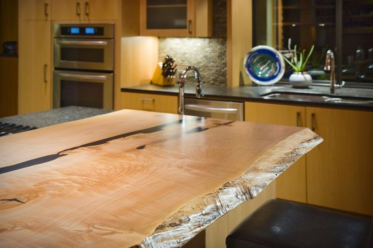 This home includes 'live edge' counters! Custom Home - Victoria BC by Road's End Contracting