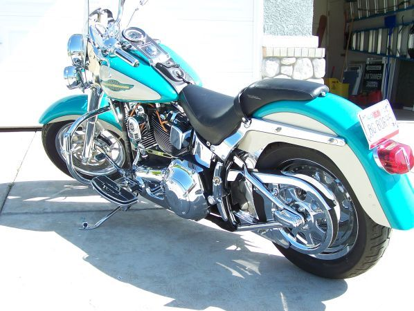 2005 Harley Fat Boy   Turquoise Metal Flake Pearl over Sand Metal Flake Pearl, Harley. Removed stock engine add Harley Davidson Big Bore Engine with performance cams and Phase three ignition down-load. Stock 88's are 1450 cc @65 horses with 95.5 ft/lbs, Big Bore is 1550 cc @118 horses with 108 ft/lbs, this is Plus 53 horses and Plus 13 ft/lbs. Harley Engines are built with