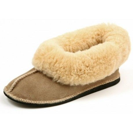 Genuine sheepswool slip-on slipper with a durable outsole offering complete comfort and warmth.
