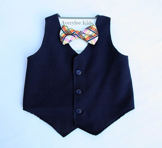 Our Boys Navy Blue vest is made with a suiting fabric that is perfect for any childs wardrobe. This blend of material creates a classy look and it