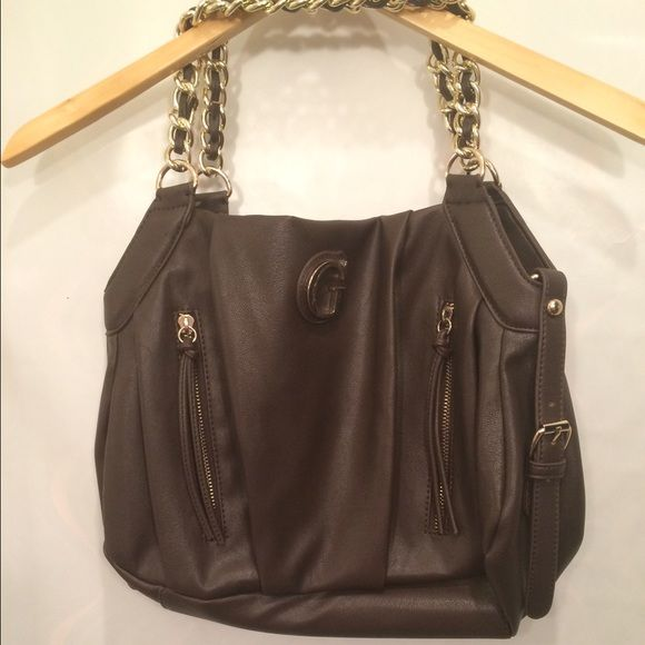 New, Authentic Guess Bag Authentic brown leather Guess bag with two chain handles. Magnetic closure, 2 pouches and a zipper pocket on inside. Brand new without tags, with protective plastic over metal parts. No trades, POSH transactions only. Guess Bags