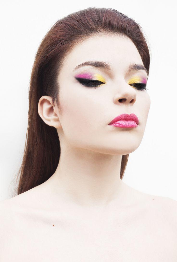 makeup: pink and yellow eyeshadow black eyeliner