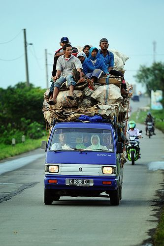 Going Home. A group of scavengers in Jepara Indonesia on small pick up car.