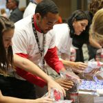 Harris Corporation Brevard County Employees Assemble Food Packs for Local Children During United Way Campaign Kickoff