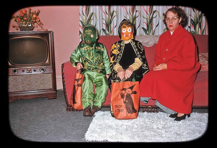 Mother doesn't look happy about taking the kids out for Halloween. 1955. I had that witch costume in the mid 70's.