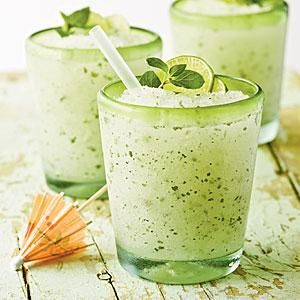 These gorgeous lime mojitos call for Key lime-flavored rum, frozen limeade, and a sprinkling of fresh mint leaves.