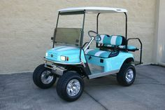"""E-Z-GO ST Custom Lifted 4 Seater from Golf Cart Wholesale with beautiful teal and white paint and a 6"""" lift kit"""