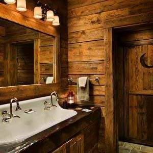 Outhouse looking door and rustic old looking bathroom.