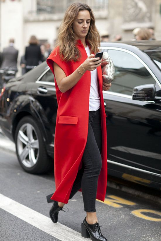 Très Chic! The Best Street Snaps at Paris Fashion Week: Channeling Little Red Riding Hood.: Taylor Tomasi Hill knows that there's more than one way to wear a scarf. : A bold red coat is all the interest any outfit needs.
