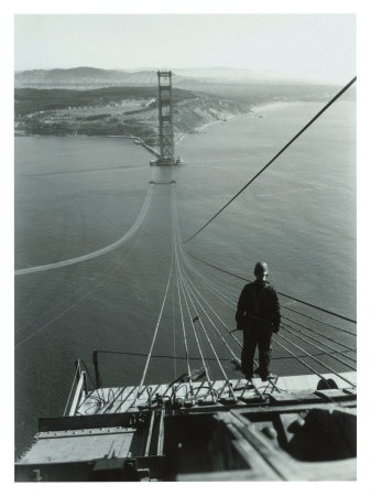 Worker atop the Golden Gate Bridge during mid-phase of construction. 1934.  A long way down!
