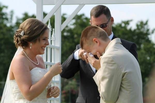A groom crying from pure joy at the most amazing, heartfelt vows of his soon-to-be wife.