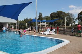 Grassed riverfront, peaceful bush setting, water skiing, slalom course, boat ramp, fishing, giant jumping pillow, go-karts, playground, basketball/tennis court, mini golf, camp kitchen, conference facilities, BBQs undercover, solar heated resort pool & water splash park and Pontoon Hire Boat.  #big4deni #holiday #holiday with kids #holidaywithdogs #caravaning