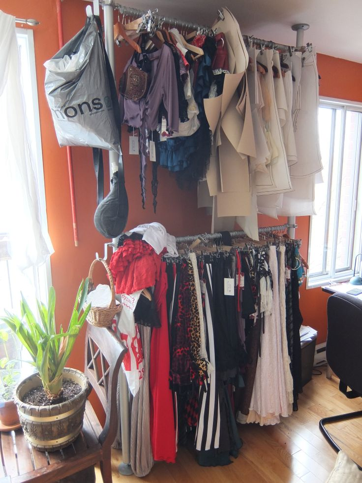 Creaturre very much less beautiful rack in the living room... with pants and skirt patterns hanging all over.