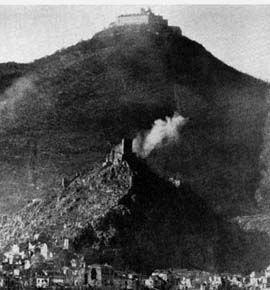 Cassino, Italy in foreground with Castle Cassino on small hill and the Monte Cassino Monastery on the large hill behind.  Photo taken 6 February 1944