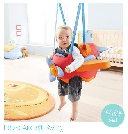Aeroplane Baby Swing  Lol. I just pictured putting a kids in something like this (with some bouncy stretchy give) and then getting in a workout right next to them. So much fun! :)