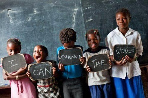 An inspirational photo of poor African kids holding up signs that spell I Can Change the World « « Mayhem & Muse