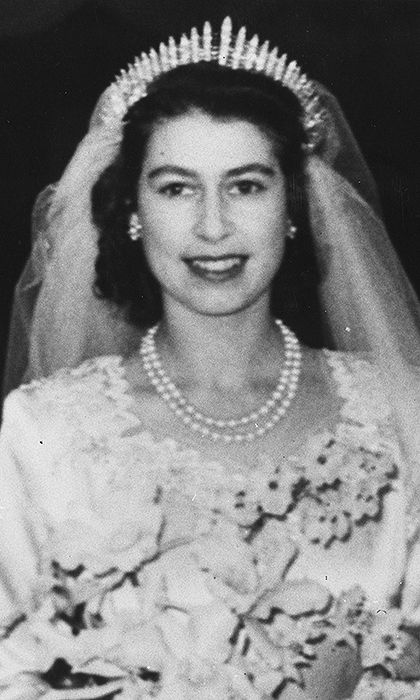 """The bride's wedding look, which included a double-strand royal heirloom pearl necklace, would not have been complete without a stunning tiara. Princess Elizabeth wore Queen Mary's Fringe Tiara, consisting of 47 diamond bars using stones taken from a necklace Queen Mary had been given by Queen Victoria.    The Fringe Tiara, passed on to Princess Elizabeth's mother in 1936, was loaned to the young Princess as the """"something borrowed"""" element of her wedding outfit.    Photo: © Getty Images"""