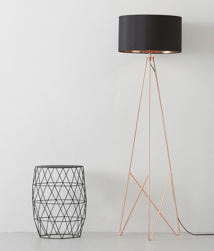 Modern geometric tripod floor lamp with shade available in two finishes either copper or gold