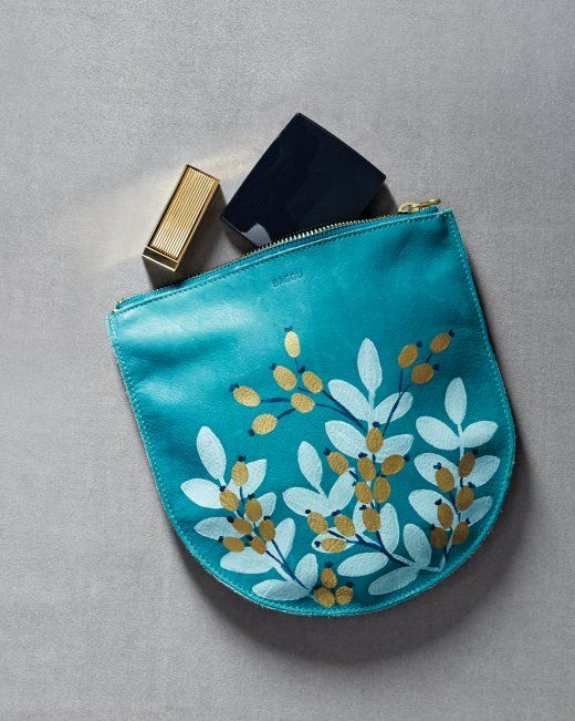 Paint artful designs on plain pouches, purses, totes and handbags with craft paint. | Martha Stewart