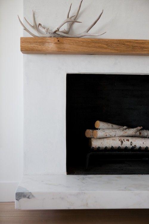 light stucco, wood mantle, black box