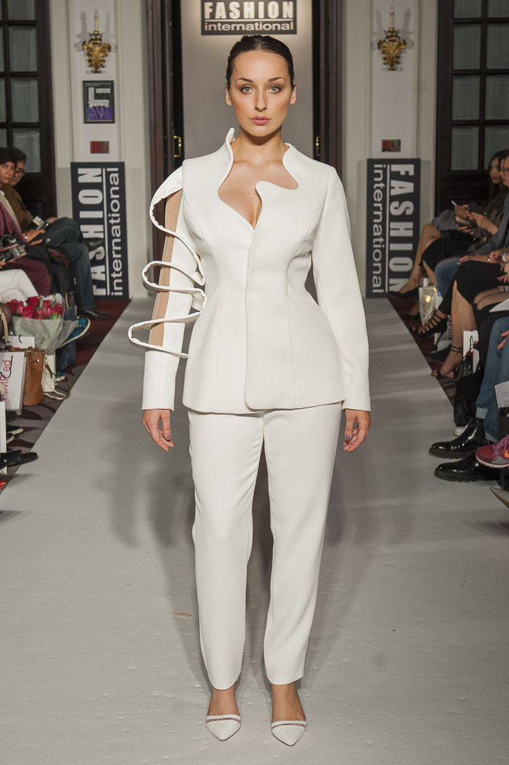 Lenie Boya S/S 2016 Haute Couture at London Fashion Week. Futuristic white crepe trousers suit with 3D bracelet sleeve and neckline.