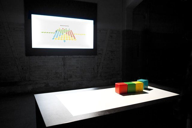 Geek Run is an interactive installation that aims to break the wall between the physical and virtual worlds by using wooden cubes as a tangible interface for a collaborative game, in combination with a Kinect controller.