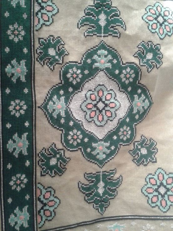"""It looks like somebody cross-stitched an Arraiolos pattern.  Sadly there is no direct translation for """"missing the point"""" in Portuguese..."""