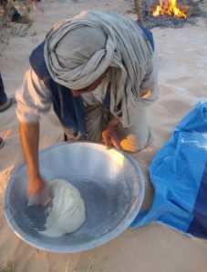 From my travels in Tunisia.  A Bedouin bread maker in the desert.